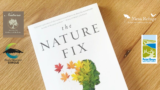 The Nature Fix book sitting on a table