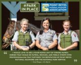 Three women Park Service Law Enforcement Rangers standing in front of a horse